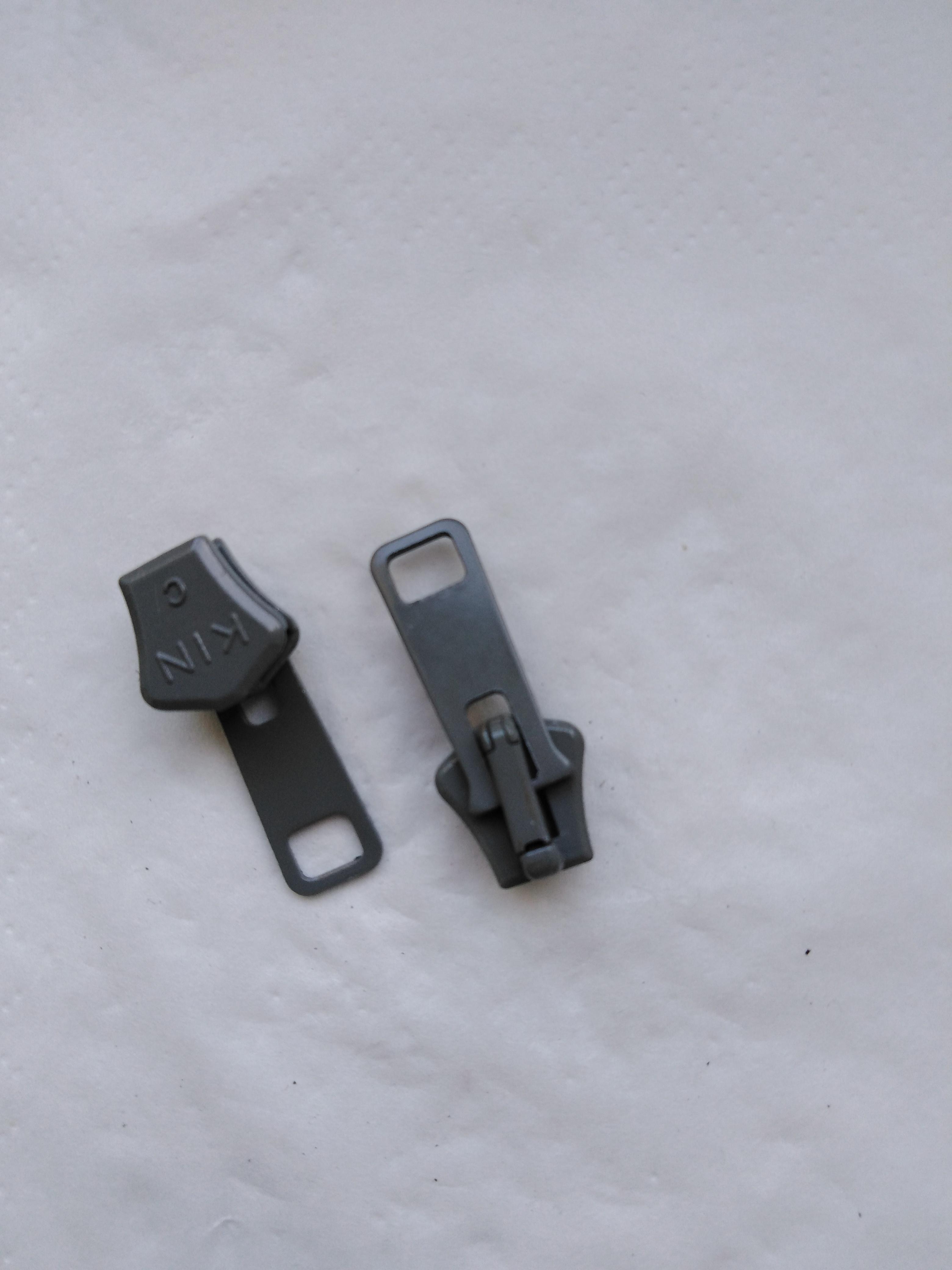 Jezdec k zipům PH6 aretační lakovaný světle šedý